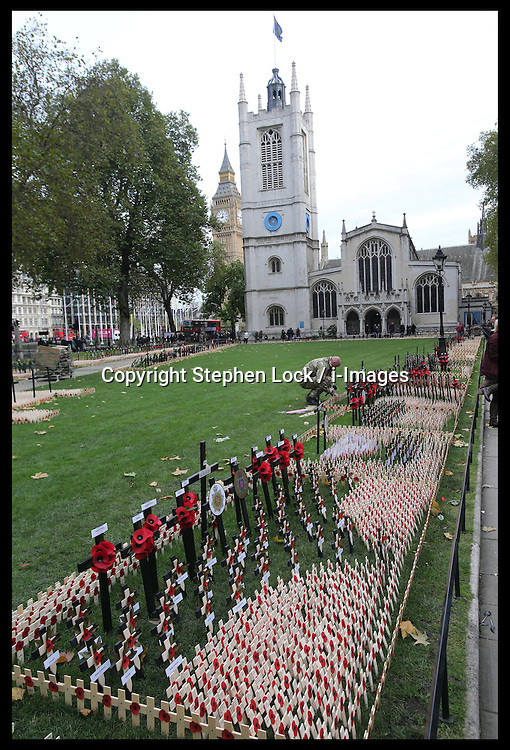 A soldier putting wooden crosses into the Field of Remembrance at Westminster Abbey in London, Tuesday 6th November 2012. The Field of Remembrance will be opened by the Duke of Edinburgh  on Thursday  8th  November 2012. Photo by: Stephen Lock / i-Images