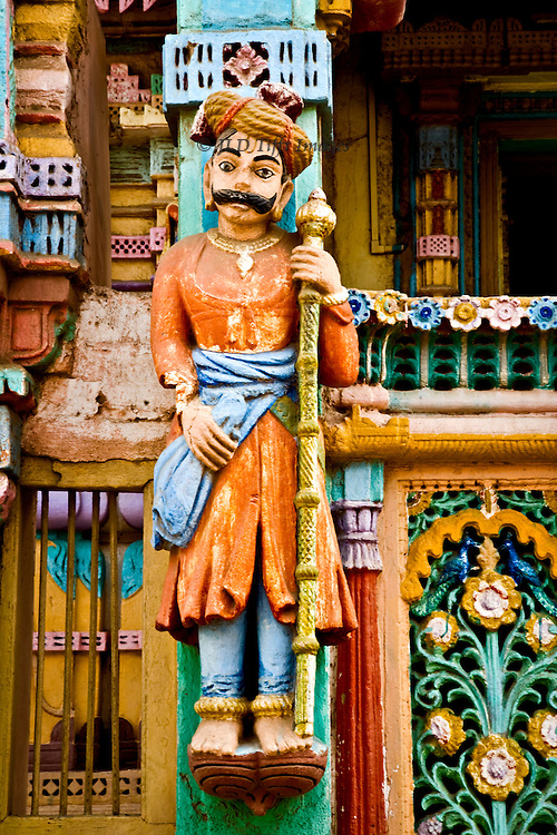 painted plaster figure of a pilgrim on the facade of a Jain temple in a Kutch village, Gujarat.