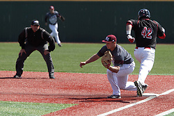 26 April 2015:  Blake Molitor runs to first trying to beat out the throw to Justin Paulsen during an NCAA Division I Baseball game between the Missouri State Bears and the Illinois State Redbirds in Duffy Bass Field, Normal IL
