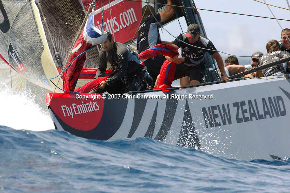 Emirates Team New Zealand NZL92 trails Alinghi SUI100 by 13 seconds at the first top mark rounding during the first race of the 32nd America`s Cup in Valencia, Spain on Saturday 23 June 2007. Alinghi won the match by 33 seconds. Photo : Chris Cameron/PHOTOSPORT