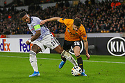 Rúben Vinagre of Wolverhampton Wanderers & Jeremain Lens of Besiktas during the Europa League match between Wolverhampton Wanderers and Besiktas at Molineux, Wolverhampton, England on 12 December 2019.