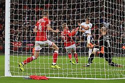 19 September 2017 -  EFL Cup (Third round) - Tottenham Hotspur v Barnsley - Adam Davies of Barnsley saves from Harry Winks of Tottenham Hotspur - Photo: Marc Atkins/Offside
