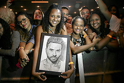 """May 6, 2018 - Rio De Janeiro, Brazil - RIO DE JANEIRO, RJ - 06.05.2018: LUIS FONSI NO RIO DE JANEIRO - The world phenomenon Luis Fonsi, presents himself for the first time to Brazil, with his? Love and Dance Tour? at Vivo Rio, in Rio de Janeiro, RJ. Interpreter of the mega hit Despacito, which has almost 5 billion views in its Youtube video, was one of the nominees of the 2018 Latin Grammy in the main category of the award: """"Recor ong of the Year"""". In the Photo: Fan tacaricature ore of Luis Fonsi. (Credit Image: © André Horta/Fotoarena via ZUMA Press)"""