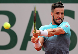 June 1, 2018 - Paris, France - DAMIR DZUMHUR of Bosnia-Herzegovina returns the ball against second-seeded Alexander Zverev of Germany during their third-round match of the French Tennis Open 2018 at Roland Garros. Zverev won 6-2, 3-6, 4-6, 7-6, 7-5. (Credit Image: © Maya Vidon-White via ZUMA Wire)