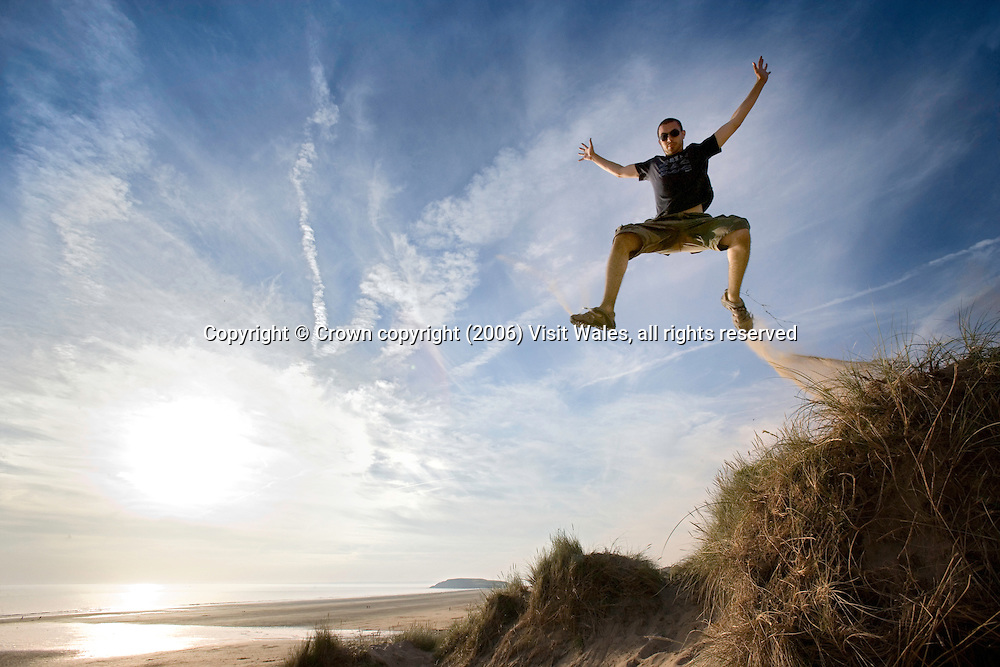 Jumping off dunes<br /> Llangennith<br /> Gower Peninsula<br /> South<br /> Lifestyle<br /> Model Photography