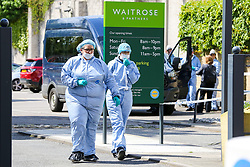 © Licensed to London News Pictures. 12/05/2019. London, UK. Forensics officers on Tollington Road at the junction of Annette Road, Islington in north London as Met police launch an investigation into the death of a man who was found in a wheelie bin behind a Waitrose store shortly before 4pm on Saturday 11 May 2019.. Photo credit: Dinendra Haria/LNP