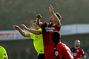 Crawley Town defender, on loan from Birmingham City, Mitch Hancox  and York City midfielder, on loan from Middlesbrough, Bryn Morris  battle in the air  during the Sky Bet League 2 match between Crawley Town and York City at the Checkatrade.com Stadium, Crawley, England on 31 October 2015. Photo by Simon Davies.