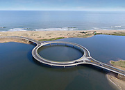 "Circular Bridge Built To Slow Down Drivers So That They Would Enjoy The View<br /> <br /> The end of 2015 saw the completion of a round bridge that stretches across Laguna Garzón between the cities of Rocha and Maldonado on the southern coast of Uruguay. Designed by Rafael Viñoly, the bridge took 12 months to complete, and replaces a traditional raft crossing while encouraging drivers to enjoy the view.<br /> ""The concept of the Puente Laguna Garzon was to transform a traditional vehicular crossing into an event that reduces the speed of the cars, to provide an opportunity to enjoy panoramic views to an amazing landscape, and at the same time create a pedestrian place in the centre,"" said Viñoly.<br /> ©Rafael Vinoly Architects/Exclusivepix Media"