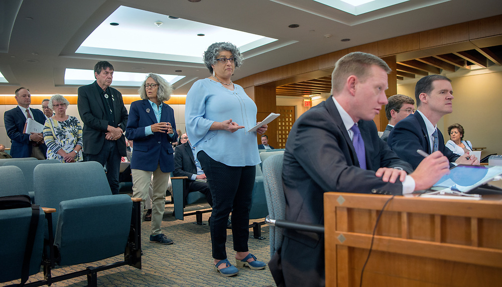 em052517a/a/From right, Rep Jason Harper, R-Rio Rancho, and Ryan Gleason, with the House Minority Office, listen as Sandra Adondakis, with the American Cancer Society, and others, speak in opposition to his tax reform bill. This was during the a meeting of the  House Labor and Economic Developement Committee on the second day of the special legislative session in Santa Fe, Thursday May 25, 2017. Harpers bill was tabled during the meeting.  (Eddie Moore/Albuquerque Journal