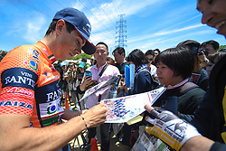 May 20, 2018 - Sakai, Osaka, Japan - Italian rider Marco Canola from team Nippo–Vini Fantini signs autographs to his fans, ahead of the opening stage, 2.6km Individual Time Trial in Daisen Park, Sakai..On Sunday, May 20, 2018, in Sakai,  Osaka Prefecture, Japan. (Credit Image: © Artur Widak/NurPhoto via ZUMA Press)