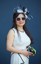 LIVERPOOL, ENGLAND - Thursday, April 9, 2015: Lucia, 26, from China wearing a cream Coast dress, during Grand Opening Day on Day One of the Aintree Grand National Festival at Aintree Racecourse. (Pic by David Rawcliffe/Propaganda)