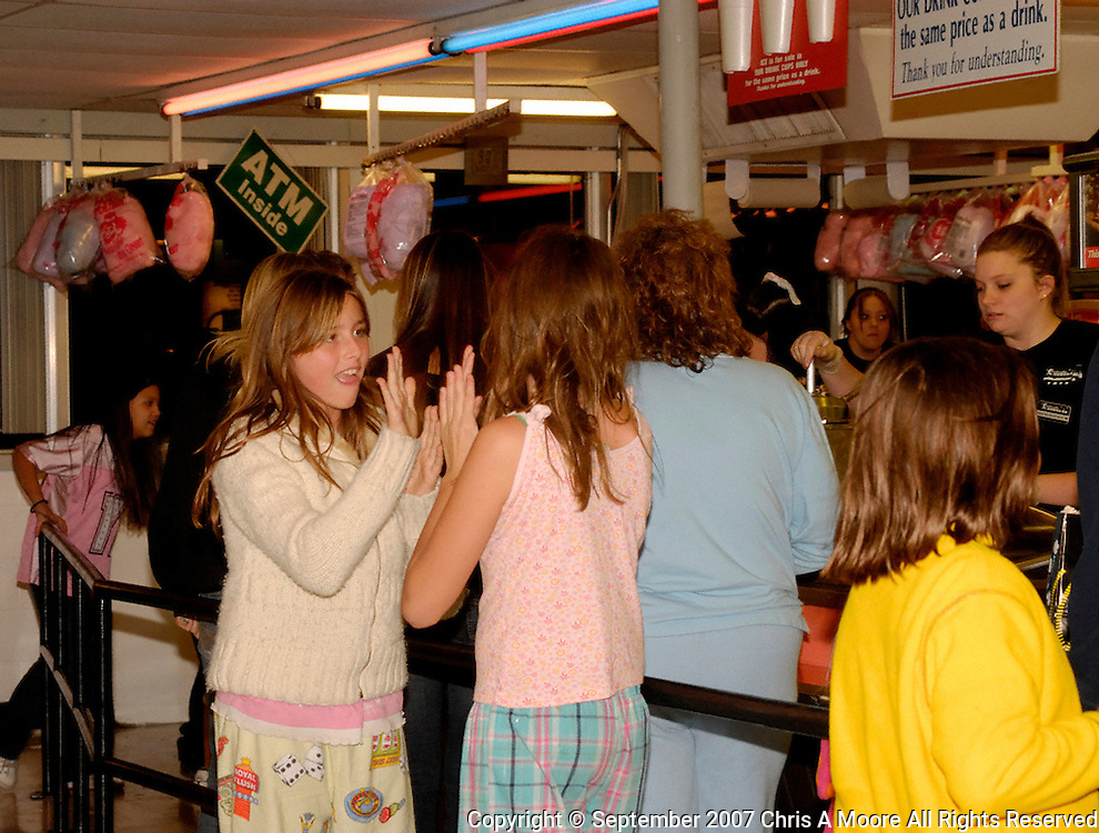 Kids enjoy a clapping game while in line at the snack bar.