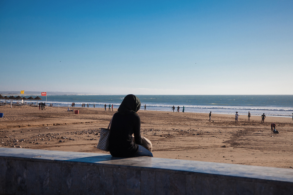 Agadir, March 2015. A girl alone sitting near the beach of Agadir.