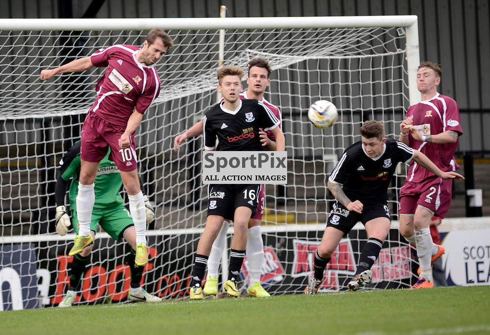 Ryn Donnelly (back shirt, No. 9 shorts) gets down low to head his sides equalising goal.<br /> Ayr United v Alloa Athletic, Scottish Cup, 1 November 2014<br /> (C) Maurice Morwood | SportPix.org.uk