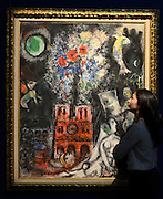 "© Licensed to London News Pictures. 14/06/2012. London, UK A woman looks at Marc Chagall's ""L'Arbre de Jesse' estimated to fetch 3-5 MillionGBP. Photocall for Sotheby's June Impressionist and Modern Art Sale this June. Photo credit : Stephen Simpson/LNP"