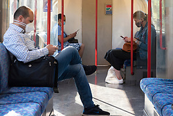 © Licensed to London News Pictures. 15/06/2020. London, UK. Morning rush hour communters on the underground wear face masks on the first day new rules come into force across England for mandatory face covering using public transport. Photo credit: Ray Tang/LNP