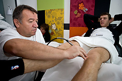 Physiotherapist  Teo Djekic and Goran Dragic of Slovenia at a rehabilitation in a Andel's Hotel during Eurobasket 2009, on September 15, 2009 in  Lodz, Poland.  (Photo by Vid Ponikvar / Sportida)