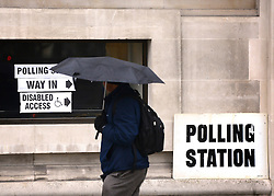 © Licensed to London News Pictures. 03/05/2012. Westminster, UK A man walks past a polling station at Central Methodist Hall during the Mayoral Elections in London today 3rd May 2012 . Photo credit : Stephen Simpson/LNP