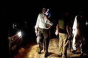 Moinuddin Syed, 42, the AVCC (Anti-Violence Crime Cell) second in command, is on his mobile phone giving instructions to his men during a night raid on the outskirts of the city of Karachi on their search for a kidnap suspect during a fake ransom meet up with the criminals. The AVCC is a special police unit mostly involved in anti-terrorism operations and kidnap cases.