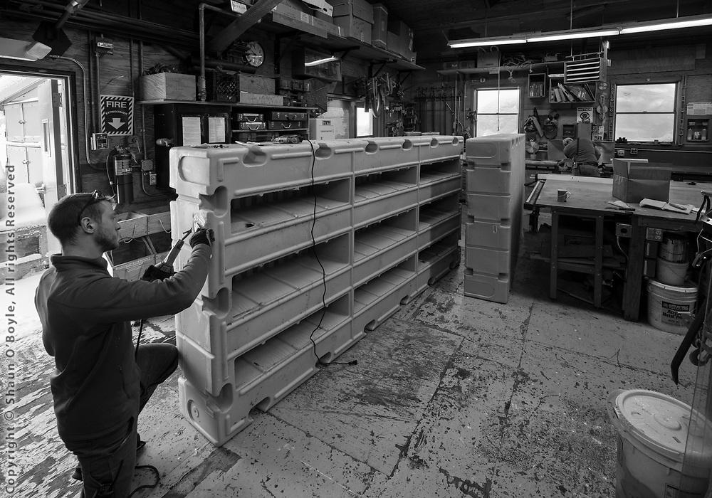 Carpenter Ian Mannix repairing floating docks in the Carps Shop
