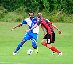 Bristol Rovers' U18s  Chad Douglas attempts to pass his man - Photo mandatory by-line: Dougie Allward/JMP - Tel: Mobile: 07966 386802 17/08/2013 - SPORT - FOOTBALL - Bristol Rovers Training Ground - Friends Life Sports Ground - Bristol - Academy - Under 18s - Youth - Bristol Rovers U18s V Bournemouth U18s