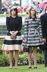 Princess's Eugenie and Beatrice during a minutes silence for Sir Henry Cecil at the opening day of Royal Ascot 2013, Tuesday, 18th June 2013<br /> Picture by Stephen Lock / i-Images