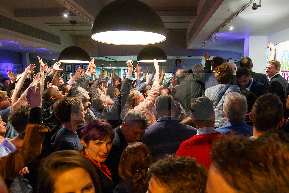 © Licensed to London News Pictures. 07/05/2016. London, UK. People listening Sadiq Khan addressing his supporters and campaign staff at the 'Brigade Bar & Bistro' near City Hall after winning the Mayoral Election in London on Saturday, 7 May 2016. Labour MP Sadiq Khan has declared his victory and accused his Conservative counterpart, Zac Goldsmith MP of using underhand tactics during the campaign. Photo credit: Tolga Akmen/LNP