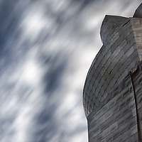 Detail of Guggenheim Bilbao museum, designed by architect Frank Gehry. Made by shapes of stone, glass and titanium on a 32,500-square-meter site along the Nervión River in the old industrial heart of the city; while modest from street level, it is most impressive when viewed from the river.