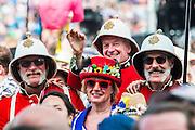 Redcoat soldiers in pith helmets watching Burt Bacharach on the Pyramid stage. The 2015 Glastonbury Festival, Worthy Farm, Glastonbury.