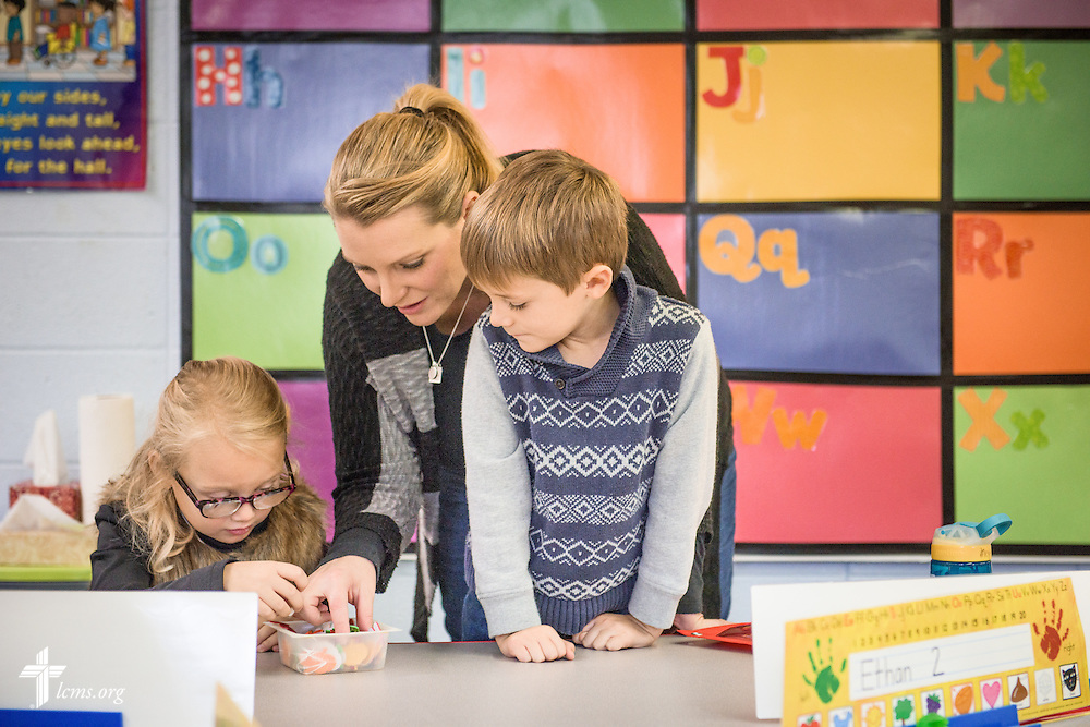 Parent Nicole Meyer helps two kindergarten students, including her son Johann, during a class activity on Friday, Oct. 28, 2016, at First Immanuel Lutheran School in Cedarburg, Wis. Meyer assists lead teacher Linda Pfeiffer part-time in the classroom and said she enjoys being able to be a part of her son's education. LCMS Communications/Erik M. Lunsford