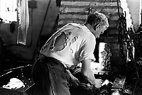 Clarrie Johnson one of the 2 remaining hand chainmakers (making chain in traditional method) at Barzillai Hingley, in Cradley Heath The Black Country, West Midlands  UK in 1977.