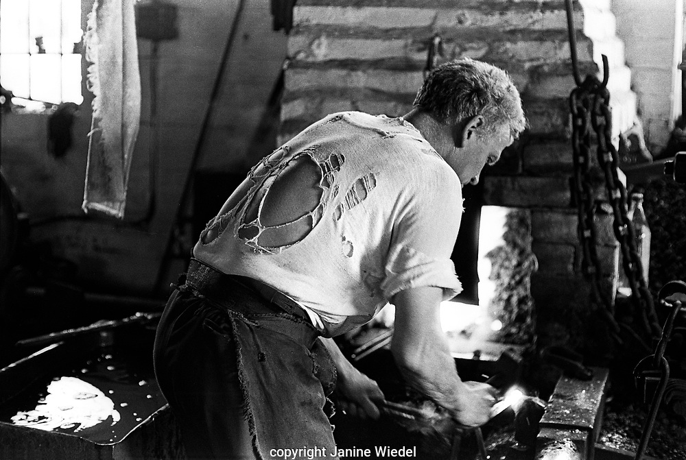 Clarrie Johnson one of the 2 remaining hand chainmakers (making chain in traditional method) in Cradley Heath The Black Country, West Midlands  UK in 1977.