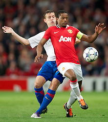 27.09.2011, Old Trafford, London, ENG, UEFA CL, Gruppe C, Manchester United (ENG) vs FC Basel (SUI), im Bild Manchester United's captain Patrice Evra in action against FC Basel 1893's Fabian Frei // during the UEFA Champions League game, group C, Manchester United (ENG) vs FC Basel (SUI) at Old Trafford stadium in London, United Kingdom on 2011/09/27. EXPA Pictures © 2011, PhotoCredit: EXPA/ Propaganda Photo/ David Rawcliff +++++ ATTENTION - OUT OF ENGLAND/GBR+++++