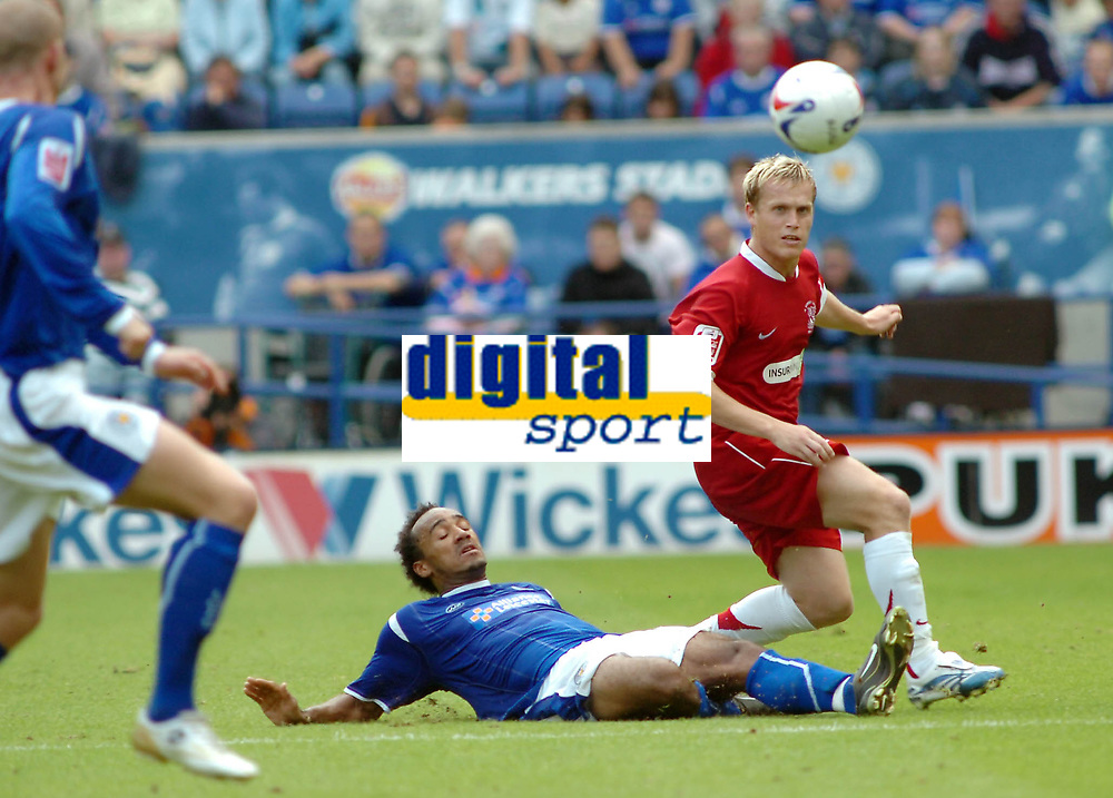 Photo: Kevin Poolman.<br />Leicester City v Southend United. Coca Cola Championship. 26/08/2006. Southend's Steve Hammell clears the ball from Chris O'Grady (Leicester).