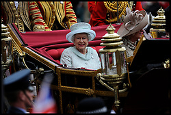 HM The Queen In her carriage on Whitehall on her way to Buckingham Palace as part of the  Queens Diamond Jubilee, Tuesday June 5, 2012. Photo By Andrew Parsons/i-Images