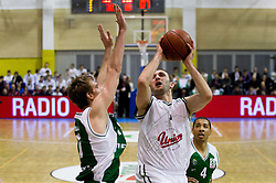 Zoran Dragic of Krka vs Goran Jeretin of Olimpija during basketball match between KK Union Olimpija Ljubljana and KK Krka Novo mesto of finals of 11th Slovenian Spar Cup 2012, on February 19, 2012 in Sports hall Brezice,  Brezice, Slovenia. (Photo By Vid Ponikvar / Sportida.com)