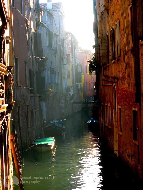 Venice is a honeycomb of waterways, bridges and boats.  With the canals bordered by tall, stacked layers of homes and apartments, finding morning sunshine is a treat.