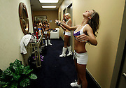 "Baltimore Ravens cheerleader hopefuls prepare before taking to the stage during an event called ""Making the Cut"" to select the 2011 Baltimore Ravens cheerleaders in Baltimore, Maryland, March 26, 2011."