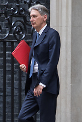 Downing Street,  London, June 27th 2015. Foreign Secretary Philip Hammond leaves the first post-Brexit cabinet meeting at 10 Downing Street.