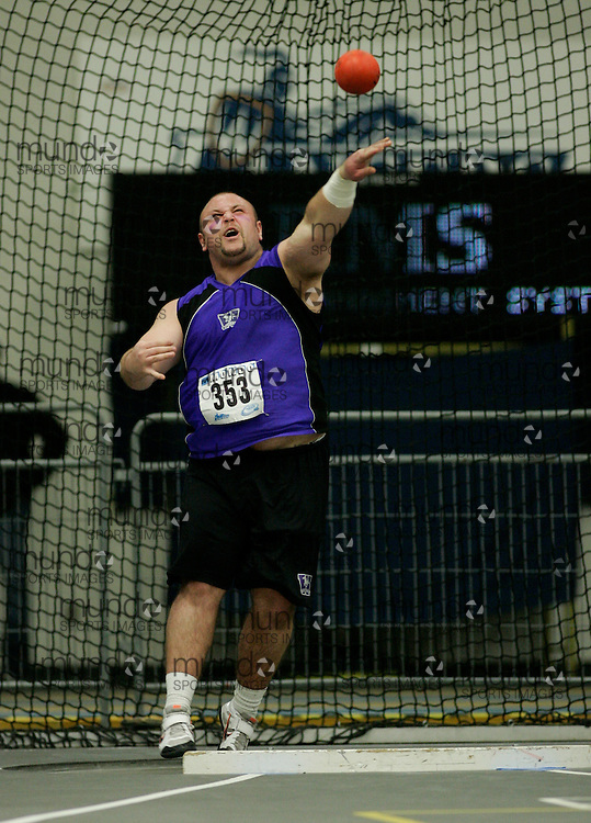 (Windsor, Ontario---13 March 2010) Dan McDonald of University of Western Ontario Mustangs   competes in the men's shot put at the 2010 Canadian Interuniversity Sport Track and Field Championships at the St. Denis Center. Photograph copyright Julie Robins/Mundo Sport Images. www.mundosportimages.com