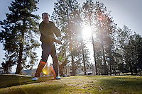 Ted McCaffree swings through a tee shot to start his round of golf Monday on the opening day for the Coeur d'Alene Public Golf Club.