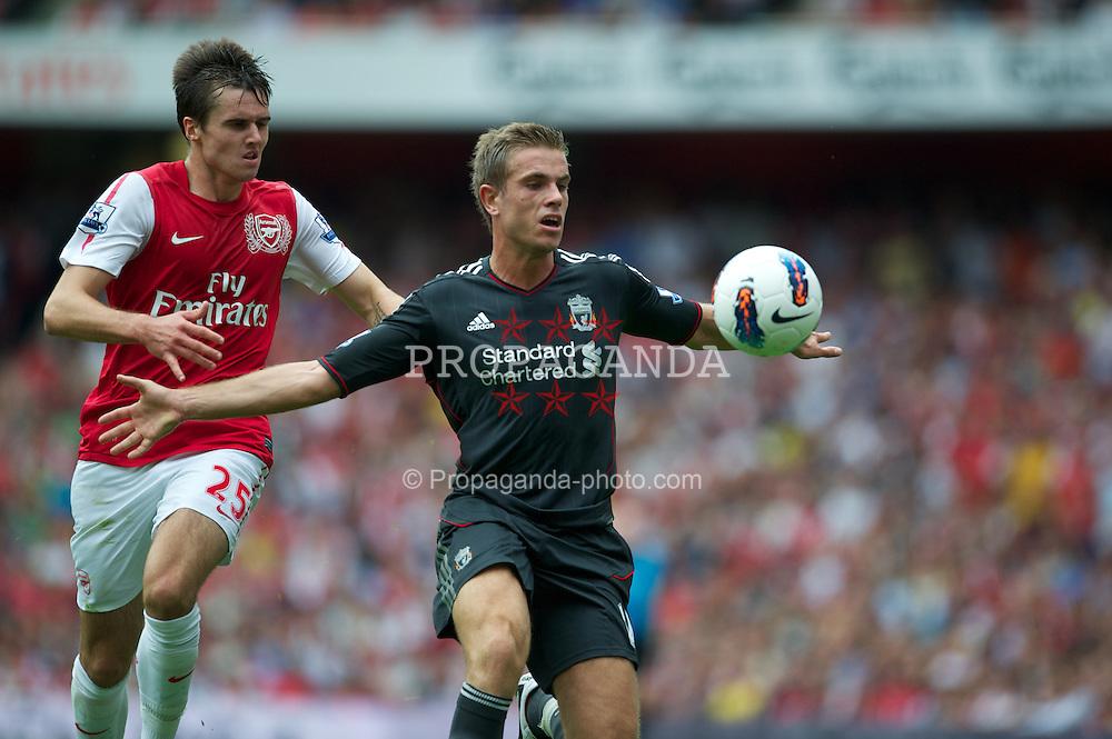 LONDON, ENGLAND - Saturday, August 20, 2011: Liverpool's Jordan Henderson in action against Arsenal's Carl Jenkinson during the Premiership match at the Emirates Stadium. (Pic by David Rawcliffe/Propaganda)