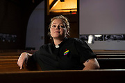 Rev. Caitlin Simpson poses for a portrait in the sanctuary of First Christian Church where she serves as the Associate Minister for <br /> Children and Young Adults in Louisiville, KY.