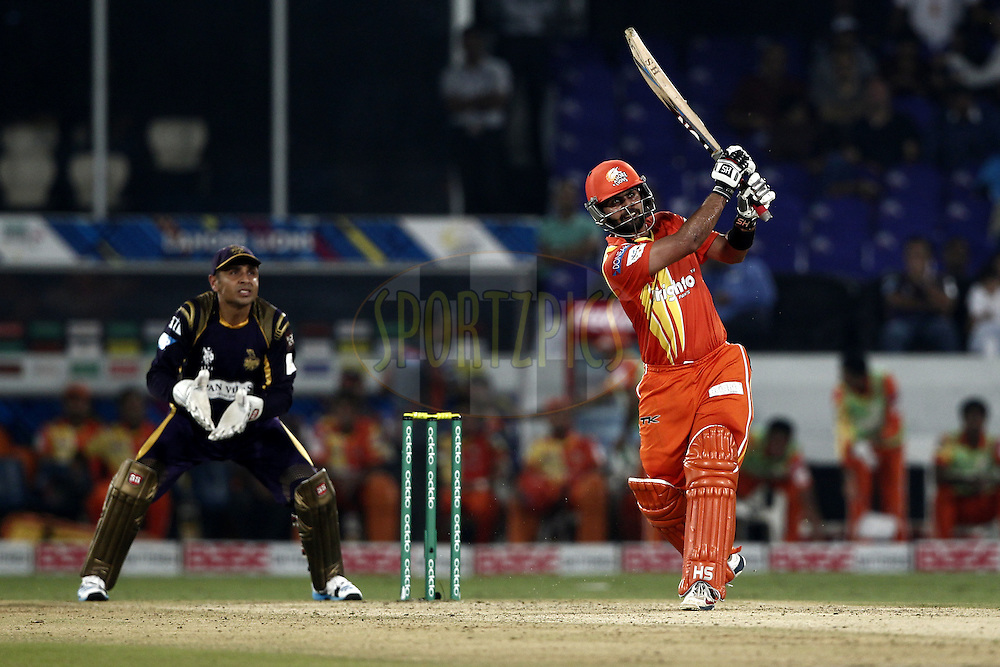Ahmed Shehzad of the LAHORE LIONS caught on boundary during match 7 of the Oppo Champions League Twenty20 between the Kolkata Knight Riders and the Lahore Lions held at the Rajiv Gandhi Cricket Stadium, Hyderabad, India on the 21st September 2014<br /> <br /> Photo by:  Deepak Malik / Sportzpics/ CLT20<br /> <br /> <br /> Image use is subject to the terms and conditions as laid out by the BCCI/ CLT20.  The terms and conditions can be downloaded here:<br /> <br /> http://sportzpics.photoshelter.com/gallery/CLT20-Image-Terms-and-Conditions-2014/G0000IfNJn535VPU/C0000QhhKadWcjYs