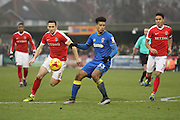 AFC Wimbledon striker Lyle Taylor (33) is persude Charlton Athletic midfielder Andrew Crofts (8) and Charlton Athletic defender Adam Chicksen (3) during the EFL Sky Bet League 1 match between AFC Wimbledon and Charlton Athletic at the Cherry Red Records Stadium, Kingston, England on 11 February 2017. Photo by Stuart Butcher.