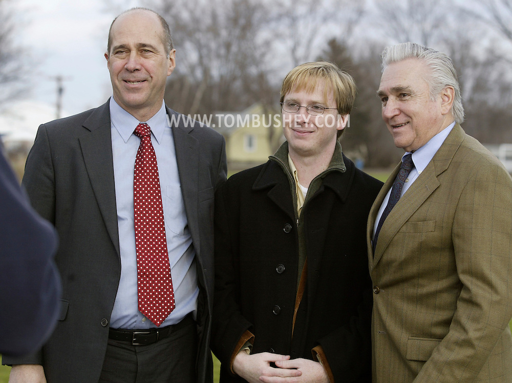 Congressmen John Hall, left, and Maurice Hinchey, right, pose for a photograph with Times Herald-Record reporter Brendan Scott in Saugerties on Dec. 28, 2006.