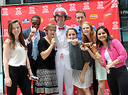 The Good Humor Man shares ice cream with fans at the launch of the Good Humor Summer of Joy campaign, Tuesday, June 24, 2014, in New York City.  Good Humor Pedicabs will travel the streets of New York for the next six weeks to give out joy rides and other fun surprises.  (Diane Bondareff/Invision for Good Humor/AP Images)