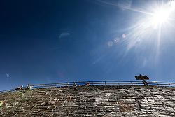 THEMENBILD - die Grossglockner Hochalpenstrasse. Die hochalpine Gebirgsstrasse verbindet die beiden oesterreichischen Bundeslaender Salzburg und Kaernten mit einer Laenge von 48 Kilometer. Sie ist als Erlebnisstrasse vorrangig von touristischer Bedeutung und das Befahren ist fuer Kraftfahrzeuge mautpflichtig, im Bild Touristen blicken von einer Mauer auf der Kaiser-Franz-Josefs-Höhe in Richtung Grossglockner, aufgenommen am 24.05.2014 // ILLUSTRATION - the Grossglockner High Alpine Road. The high alpine mountain road connects the two Austrian federal states of Salzburg and Carinthia with a length of 48 kilometers. It is as a matter of priority road experience of tourist importance and for driving motor vehicles is a toll road. Picture taken on 2014/05/24. EXPA Pictures © 2014, PhotoCredit: EXPA/ JFK