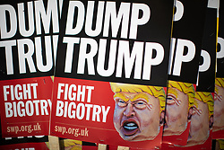 © Licensed to London News Pictures . 03/06/2019. Manchester, UK. DUMP TRUMP FIGHT BIGOTRY placards by the Socialist Workers Party . A Manchester Together Against Trump demonstration in Cathedral Gardens , central Manchester , during the first day of US President Donald Trump's visit to the UK . Photo credit: Joel Goodman/LNP
