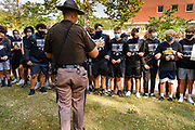 07 SEPTEMBER 2020 - DES MOINES, IOWA: An Iowa State Trooper confronts high school students picketing the Governor's Mansion. About 300 Des Moines Public School (DMPS) high school athletes marched through Des Moines to the Governor's Mansion Monday to protest Gov. Kim Reynolds' recent efforts to reopen schools. DMPS, the largest school district in Iowa, is suing to go to online instruction because of the COVID-19 pandemic. The Governor is trying to force the district to reopen with in person instruction. The state ruled that schools using online education can't participate in extracurricular activities, including sports. The student athletes, who all wore face masks to comply with CDC guidelines, were marching to demand the ability to participate in sports despite using online instruction.   PHOTO BY JACK KURTZ